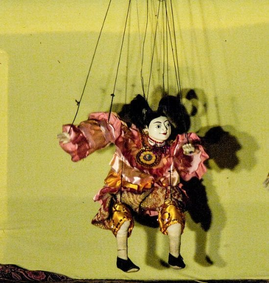 Image of a Puppet under the coercive control of the puppet master